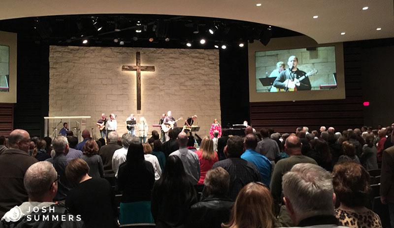 Josh Summers leading worship at a church