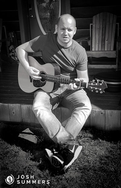 Josh Summers playing the guitar